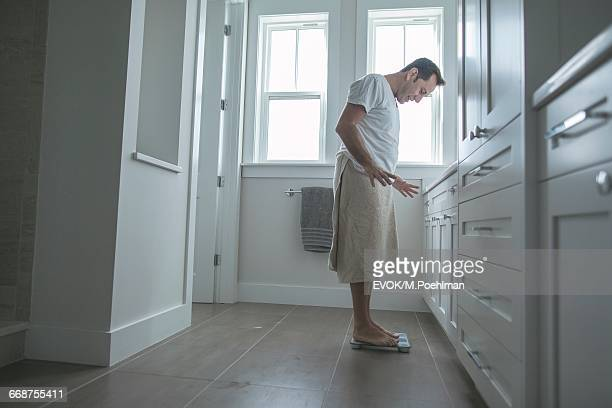 Man on bathroom scale