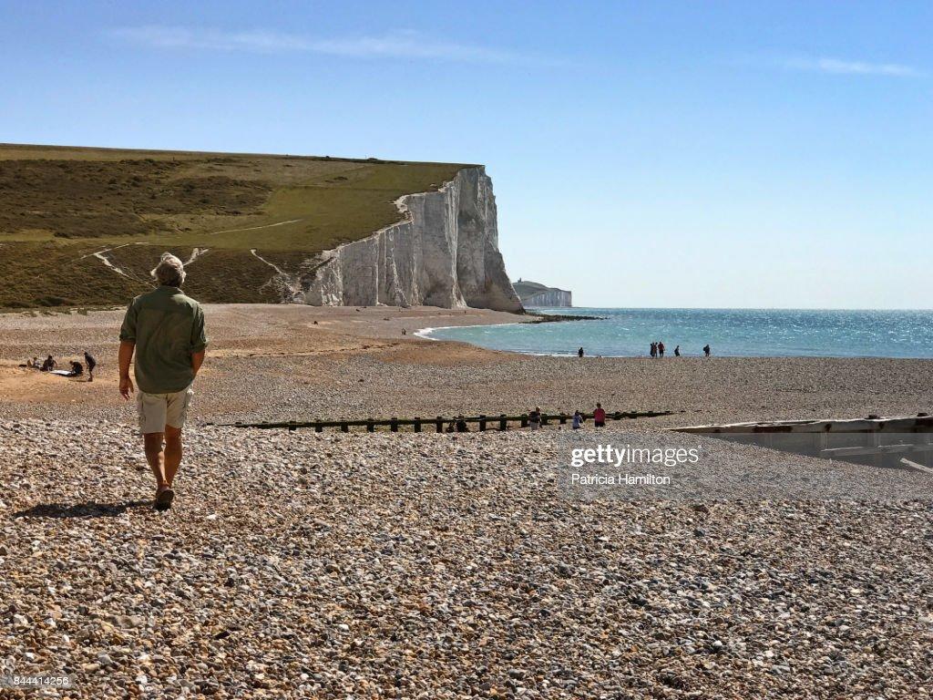 Man on beach at Cuckmere Haven : Stock Photo