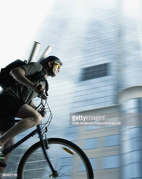 Man on bicycle delivering message