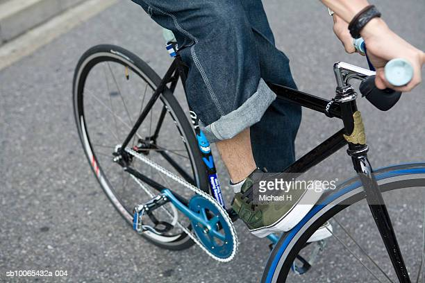 Man on bicycle, low section