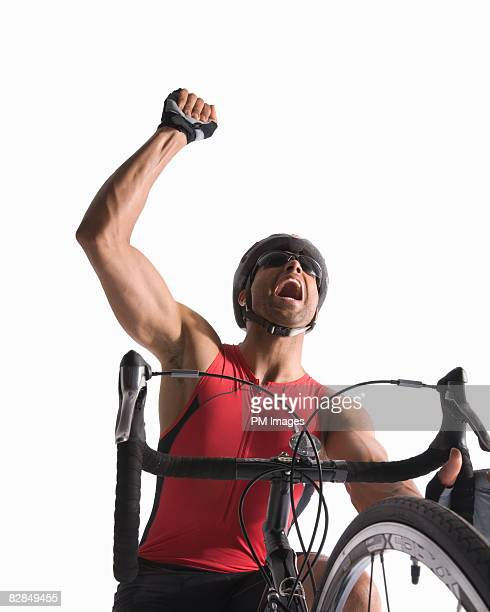 Man on bicycle, pumping his fist