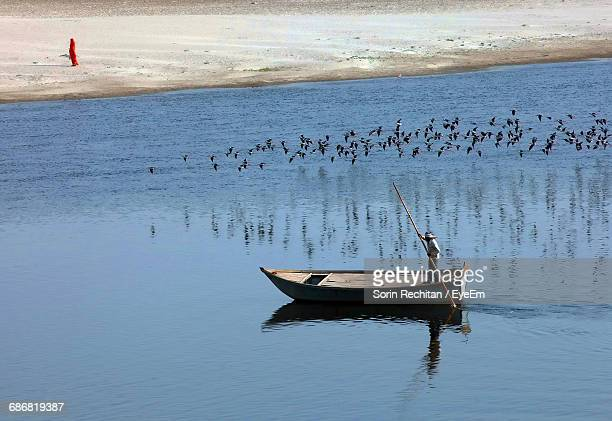 man on boat in yamuna river - yamuna river stock pictures, royalty-free photos & images