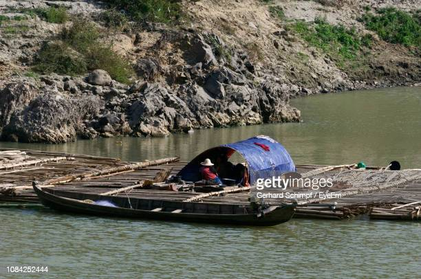 man on boat sailing in river - gerhard schimpf stock pictures, royalty-free photos & images