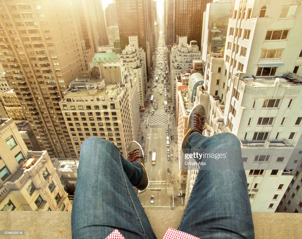 Man On Building Terrace Above New York City : Stock Photo