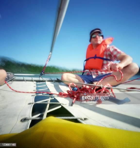 Man on catamaran sail boat