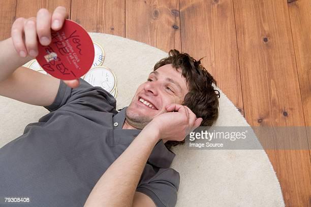 Man on cellphone holding beer mat