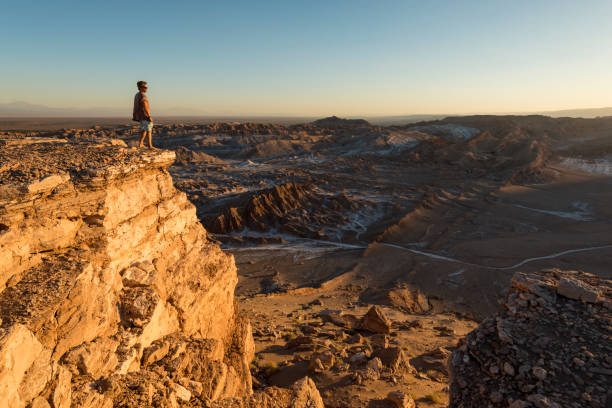Man on cliff, Valle de la Luna (Valley of the Moon), Atacama Desert, El Norte Grande, Chile