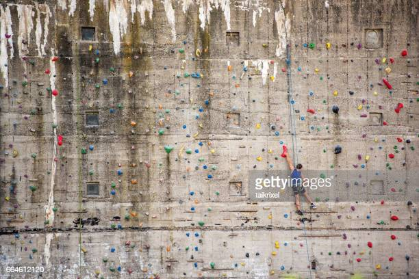 Man on climbing wall, Germany, Europe