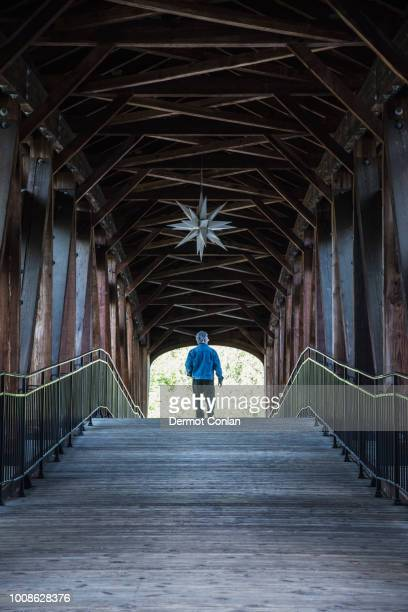 man on covered bridge - winston salem stock pictures, royalty-free photos & images
