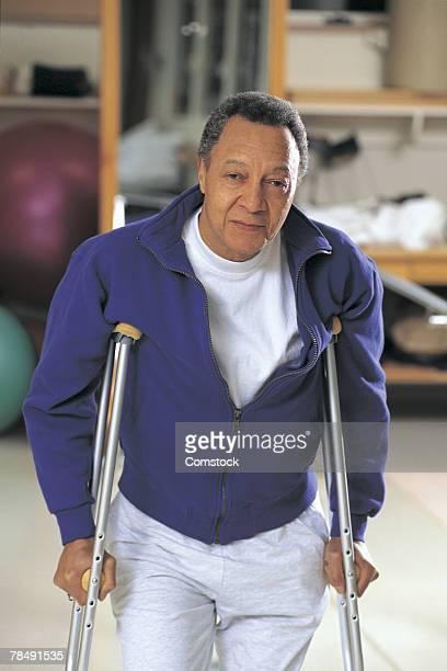 Man on crutches posing