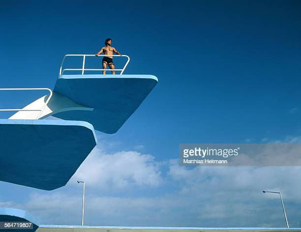 Man on diving platform