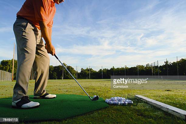 man on driving range - driving range stock pictures, royalty-free photos & images