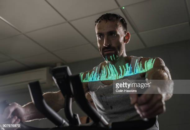 Man on exercise bike with infographic