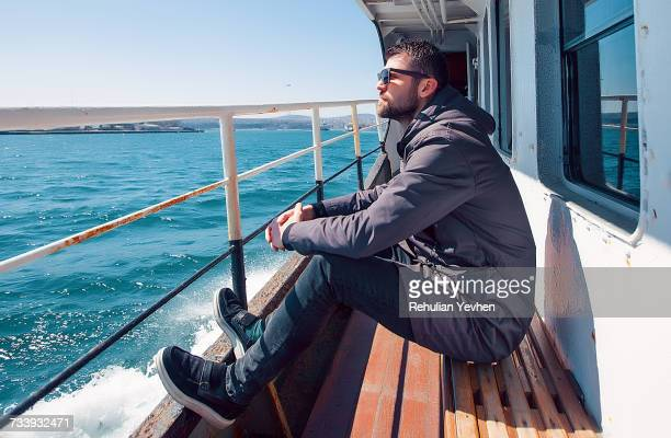 man on ferry looking away at view, istanbul, turkey - ferry stock photos and pictures