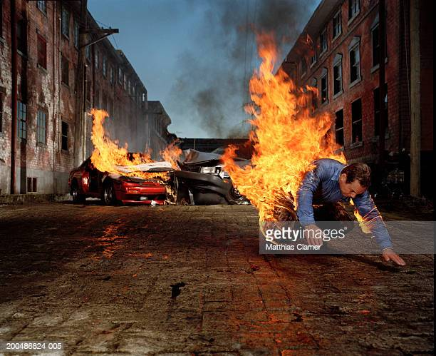 Man on fire hurtling away from auto collision