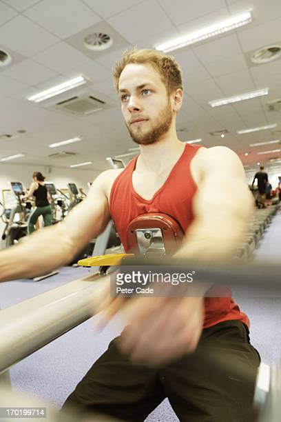Man on fitness machine in gym
