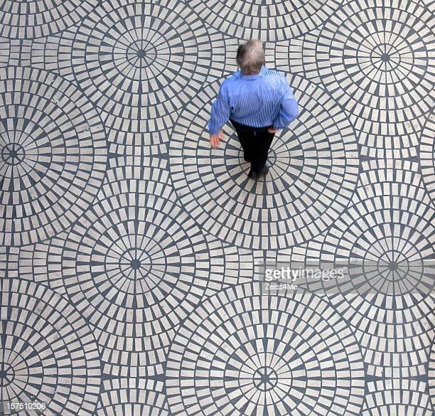 Man on geometric tiles