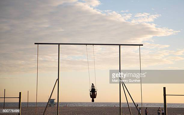 man on gym rings, venice beach - santa monica stock pictures, royalty-free photos & images