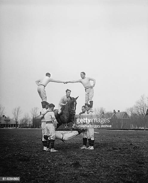 Man on Horse Jumping Through Pyramid of Acrobatic Men circa 1931
