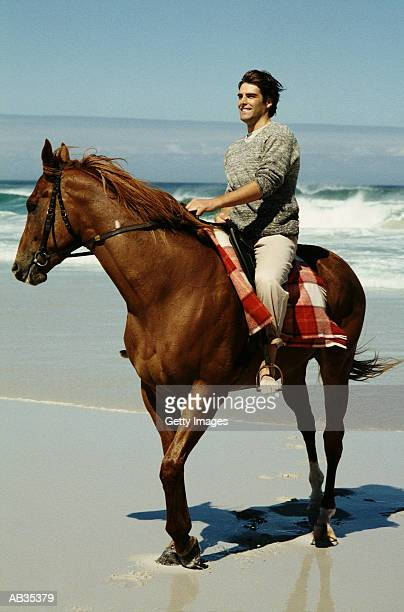 Man on horseback on beach