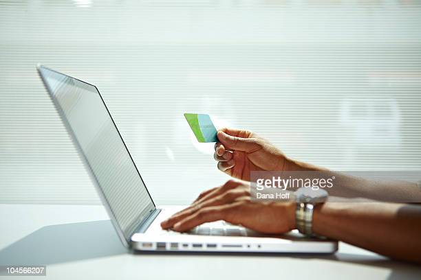 Man on laptop internet buying something with credi