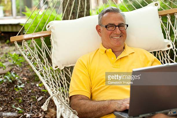 man on laptop on computer - lying on back photos stock pictures, royalty-free photos & images