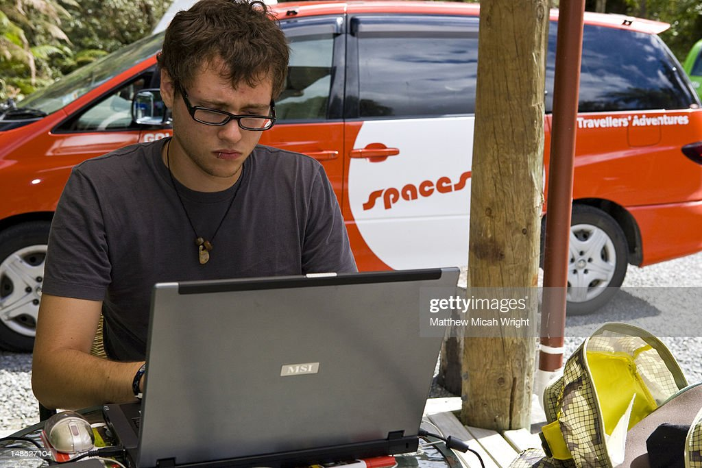 Man On Laptop With Rental Car In Background High Res Stock Photo Getty Images