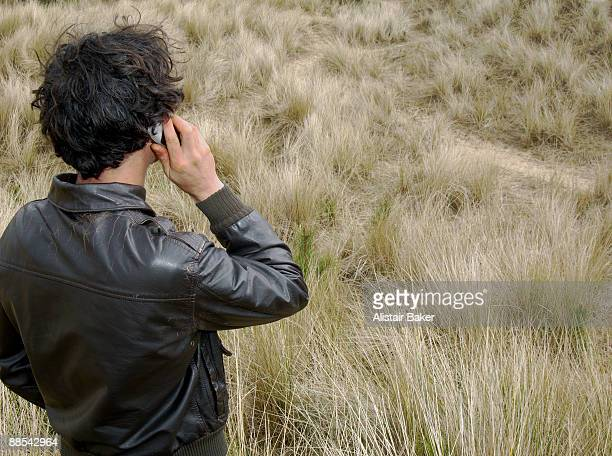 Man on mobile in grass