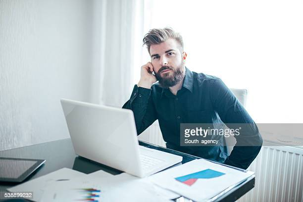 Man on mobile in office