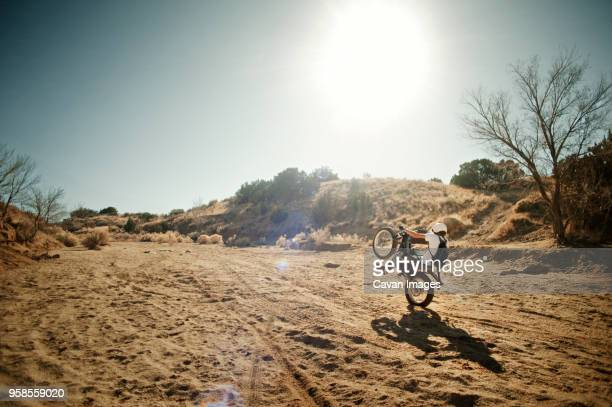 man on motorcycle performing wheelie - stunt person stock photos and pictures
