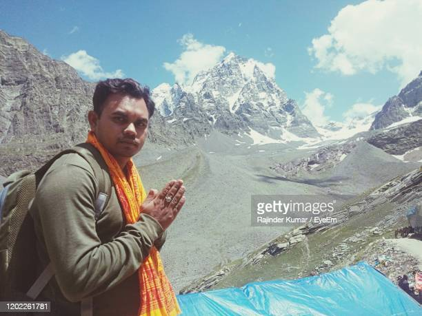 man on mountain against sky - panchkula stock pictures, royalty-free photos & images