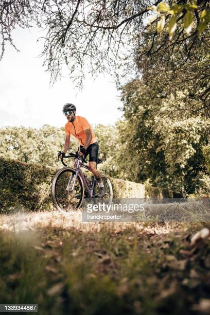 man on mountain bike in the nature - individual event stock pictures, royalty-free photos & images