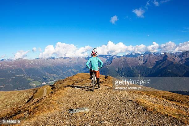 Man on mountain bike looking at view