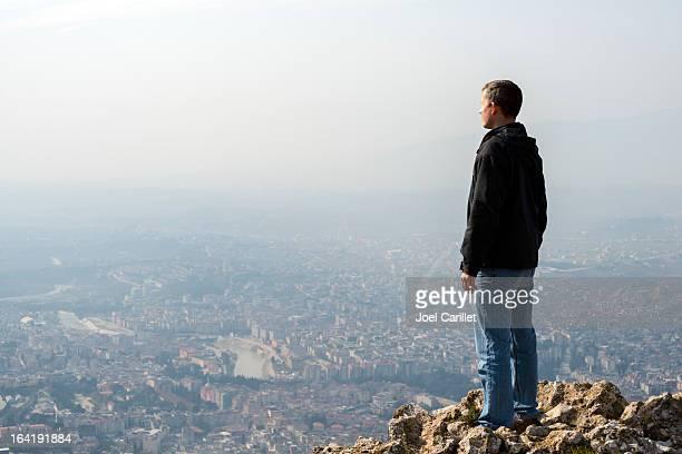 man on mountaintop overlooking city of antakya, turkey - hatay stockfoto's en -beelden