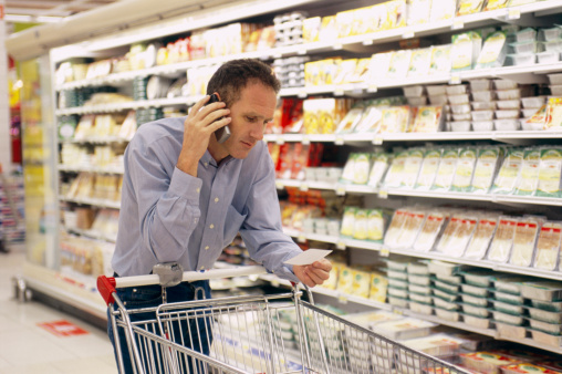Man on Phone in Supermarket - gettyimageskorea