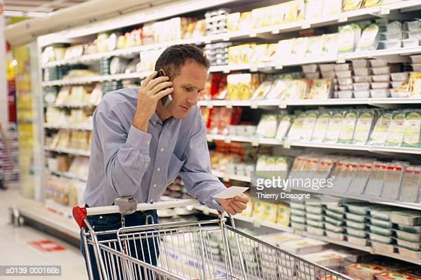 Man on Phone in Supermarket