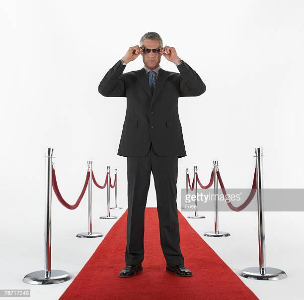man on red carpet - film premiere stock pictures, royalty-free photos & images