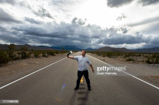 man on road under moody sky - in the center stock pictures, royalty-free photos & images