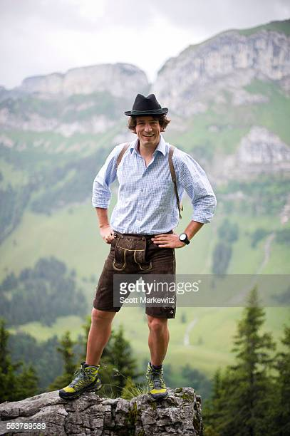 man on rocks, appenzellerland, switzerland. - traditional clothing stock pictures, royalty-free photos & images