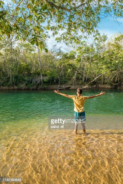 man on shallow formoso river in bonito - mato grosso do sul state stock pictures, royalty-free photos & images