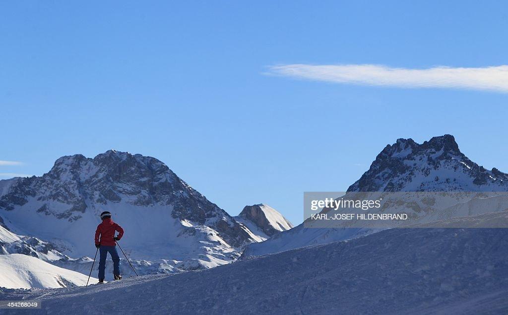 A man on ski looks down the Fellhorn near Oberstdorf, southern Germany, on December 8, 2013. Wintersports season started on December 7, 2013.