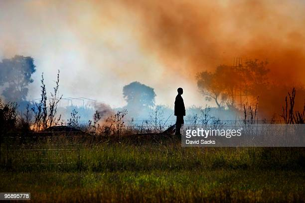 Man on smoky field