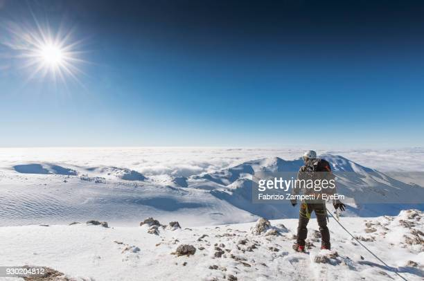 man on snowcapped landscape against clear sky - fabrizio zampetti foto e immagini stock