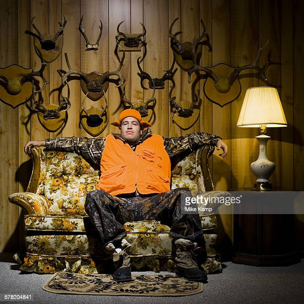 Man on sofa with antlers