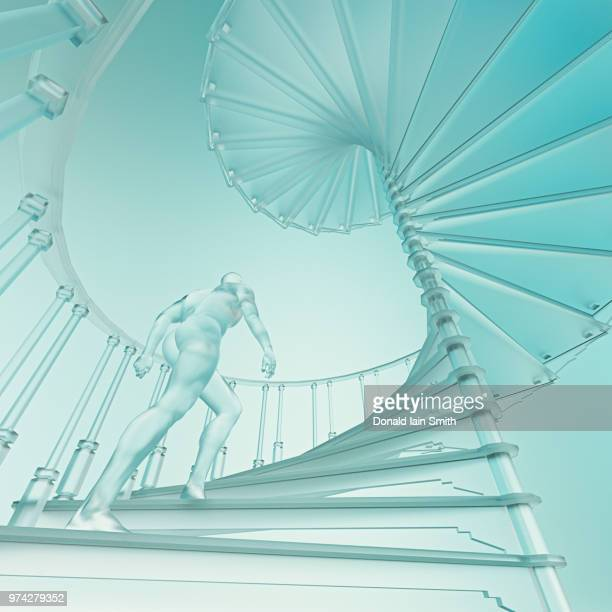 Man on spiral staircase climbing upwards