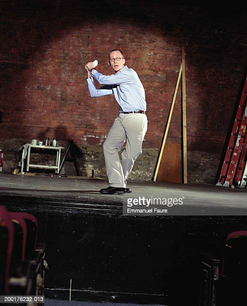 man on stage in theater in baseball position - audition stock pictures, royalty-free photos & images