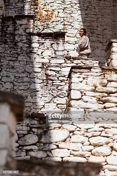 man on stairway at kurjey lhakhang monastery - merten snijders stock pictures, royalty-free photos & images