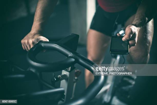 man on stationary bicycle - leisure facilities stock pictures, royalty-free photos & images