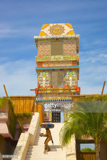 Man on steps of Mayan-style observation tower at Mahahual