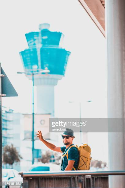 man on street calling taxi - taxiway stock pictures, royalty-free photos & images